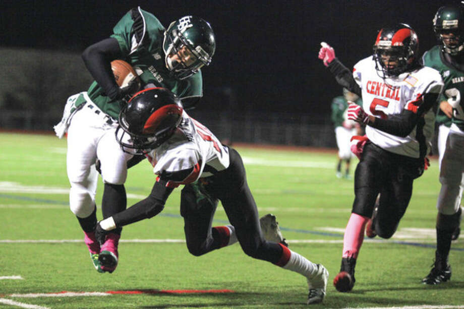 Hour photo/Chris PalermoNorwalk's Yesid Rodriguez is knocked out of bounds during Friday night's game against Bridgeport Central at Testa Field. / © 2013 Hour Newspapers All Rights Reserved