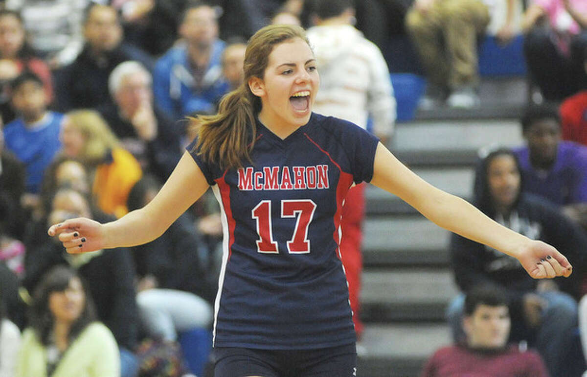 Hour photo/John Nash Brien McMahon volleyball player Claire Kostohyrz reacts after her team won the first game during Friday's regular season finale against Trinity Catholic. The Senators won the next two, too, and the victory earned them a trip to the state tournament.