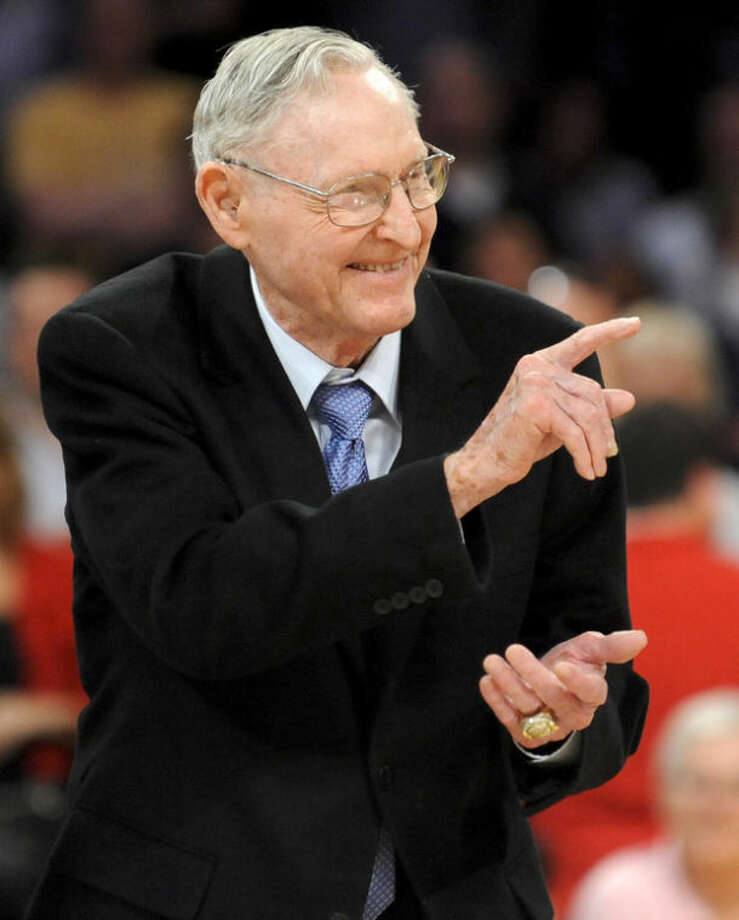 FILE - In this April 6, 2012, file photo, Bill Sharman gesturing as he is honored along with other members of the 1974 Los Angeles Lakers Championship team, in Los Angeles. Sharman, the Hall of Famer who won NBA titles as a player for the Boston Celtics and a coach for the Los Angeles Lakers, has died. He was 87. Sharman died Friday, Oct. 25, 2013, at his home in Redondo Beach, the Lakers announced. (AP Photo/Gus Ruelas, File)