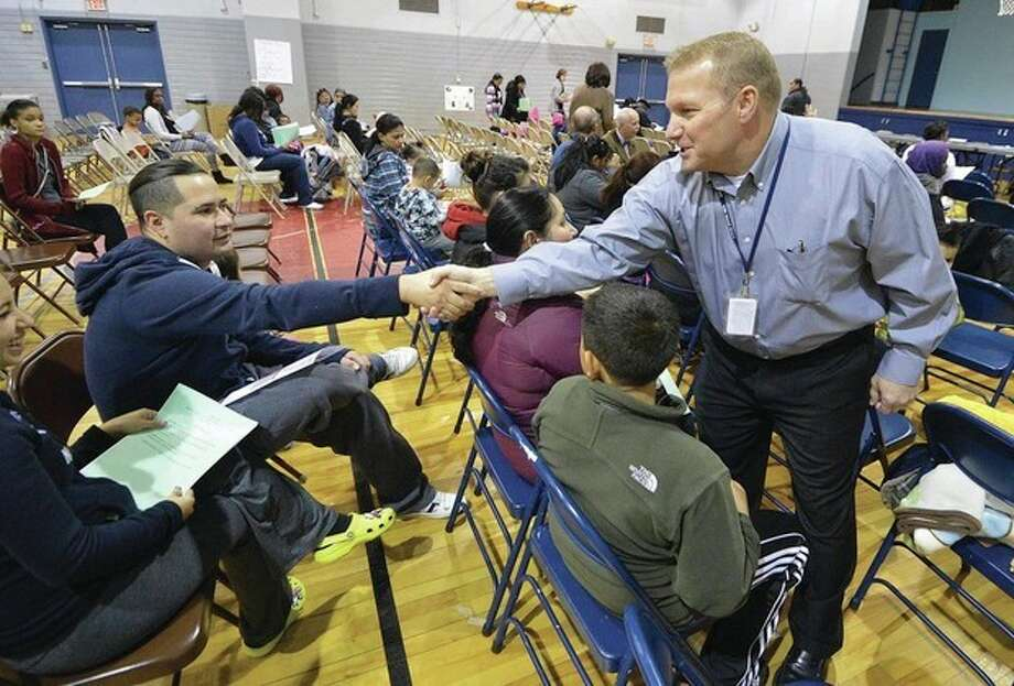 Hour Photo/Alex von Kleydorff. Brett Parmenter a field worker with CDI introduces himself around the room during a Head Start meeting at Nathaniel Ely school