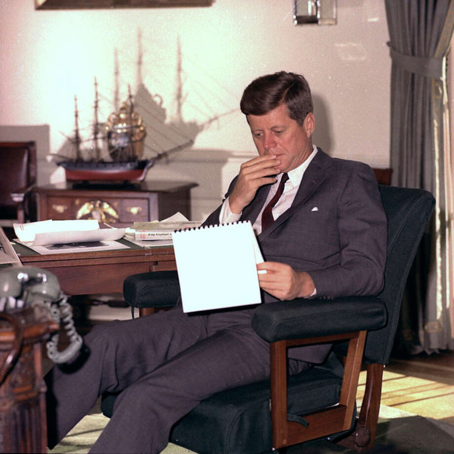 FILE - In this Jan. 18, 1962 file photo, U.S. President John F. Kennedy looks over notes at his desk in the White House. (AP Photo/Henry Burroughs) / AP