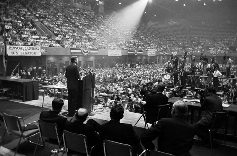 FILE - In this Aug. 21, 1960 file photo, illuminated by a spotlight, Sen. John F. Kennedy, Democratic presidential nominee, speaks to an audience in Des Moines, Iowa. (AP Photo) / AP