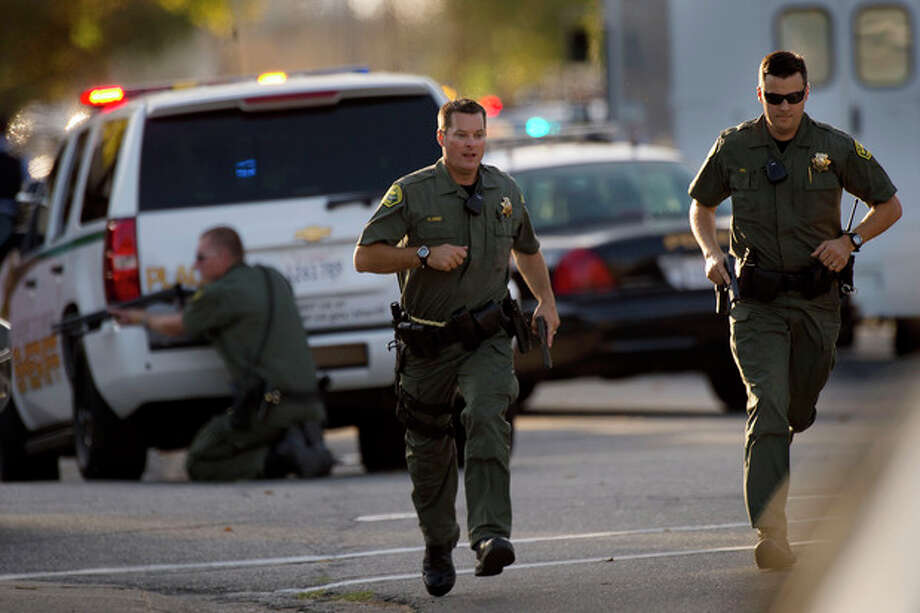 Police converge on a house where Sammy Duran is suspected to be residing on Friday, Oct. 25, 2013, in Roseville, Calif. Duran is a suspect in the shooting of three law enforcement officers that occurred Friday. Roseville police Lt. Cal Walstad told reporters that officers believe they have the suspect surrounded in a house, although he was not in custody. (AP Photo/The Sacramento Bee, Randall Benton) MAGS OUT; LOCAL TV OUT (KCRA3, KXTV10, KOVR13, KUVS19, KMAZ31, KTXL40); MANDATORY CREDIT; ONLN OUT; IONLN OUT / The Sacramento Bee