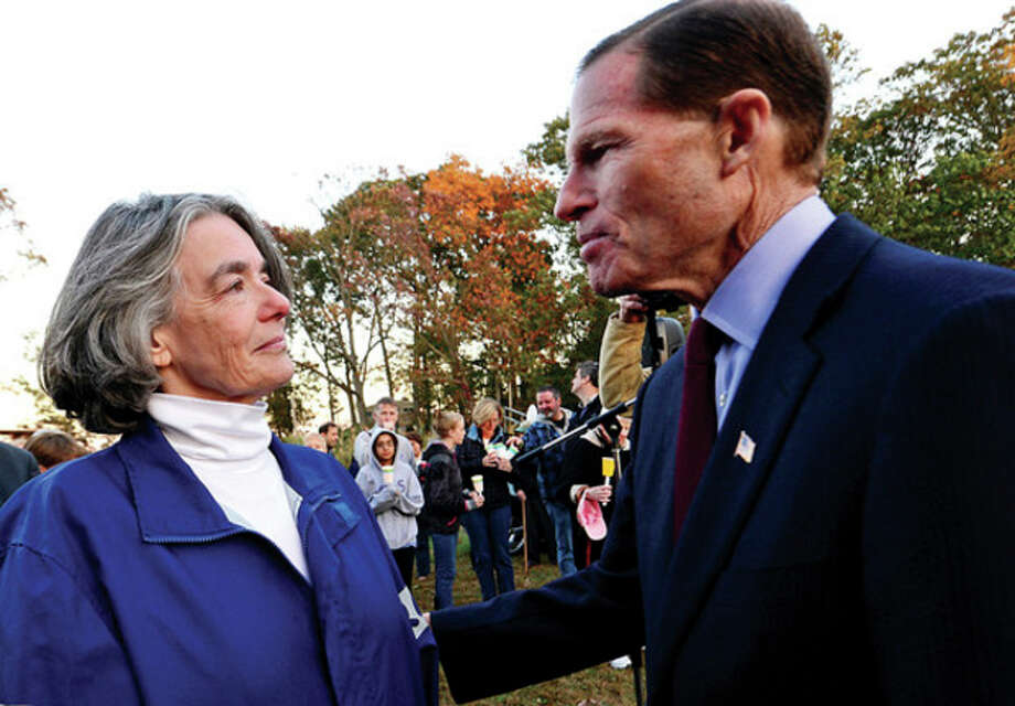 U.S. Sen. Richard Blumenthal gives his support to Maggie Willcox, wife of Capt. Peter Willcox, during a candlelight vigil for him and the crew of Greenpeace's Arctic Sunrise Saturday at Village Creek. / (C)2013, The Hour Newspapers, all rights reserved