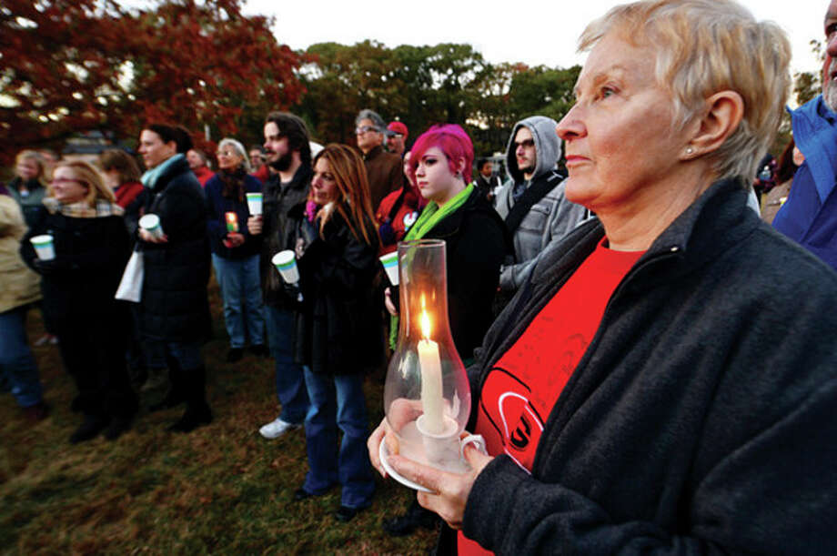 Hour photo / Erik TrautmannMarcia Powell attends a candlelight vigil for Capt. Peter Willcox and the crew of Greenpeace's Arctic Sunrise Saturday at Village Creek. / (C)2013, The Hour Newspapers, all rights reserved