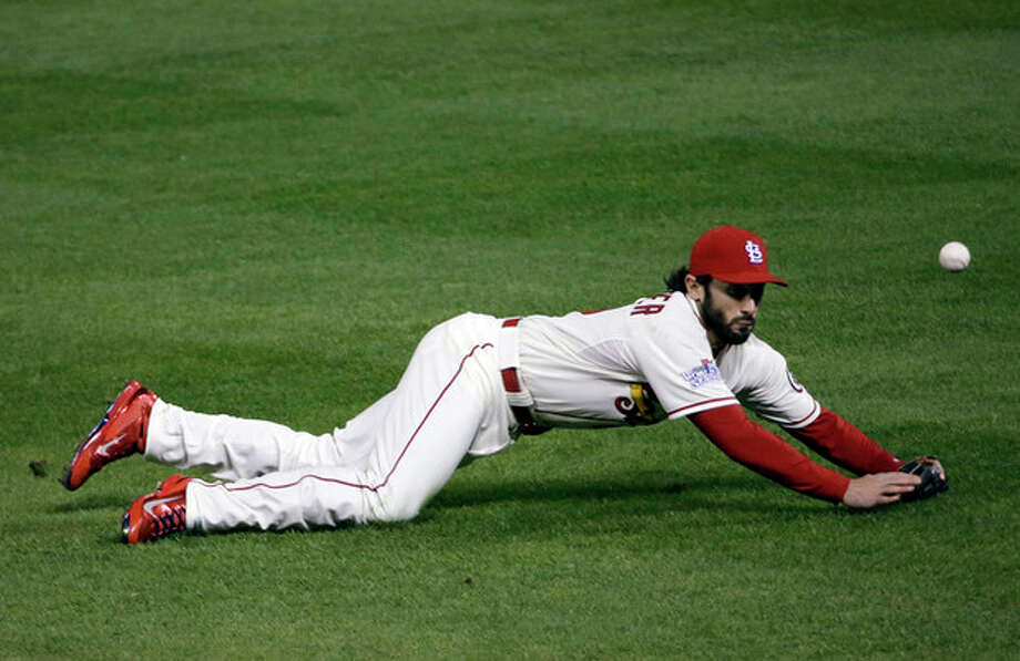 St. Louis Cardinals' Matt Carpenter can't catch a ball hit by Boston Red Sox's Jacoby Ellsbury during the fourth inning of Game 3 of baseball's World Series Saturday, Oct. 26, 2013, in St. Louis. (AP Photo/David J. Phillip) / AP