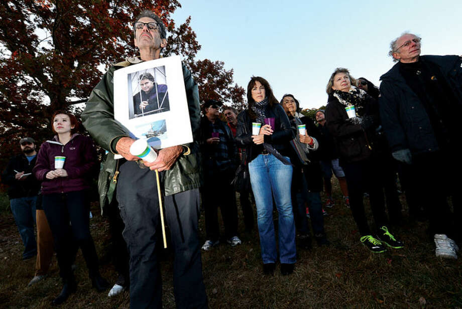 Hour photo / Erik Trautmann Willie Kaye attends a candlelight vigil for Capt. Peter Wilcox and the crew of Greenpeace's Arctic Sunrise saturday at Village Creek. Wilcox and his crew are currently imprisoned in Russia on hooliganism charges after demonstrating in the arctic.