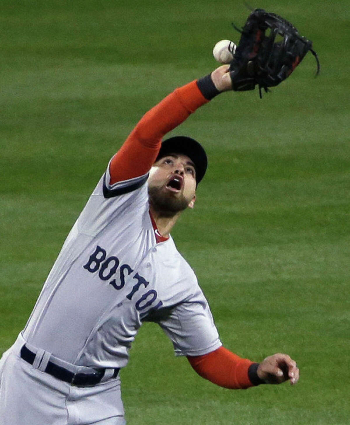 Boston Red Sox's Jacoby Ellsbury can't catch a ball hit by St. Louis Cardinals' Matt Holliday during the third inning of Game 3 of baseball's World Series Saturday, Oct. 26, 2013, in St. Louis. (AP Photo/David J. Phillip)