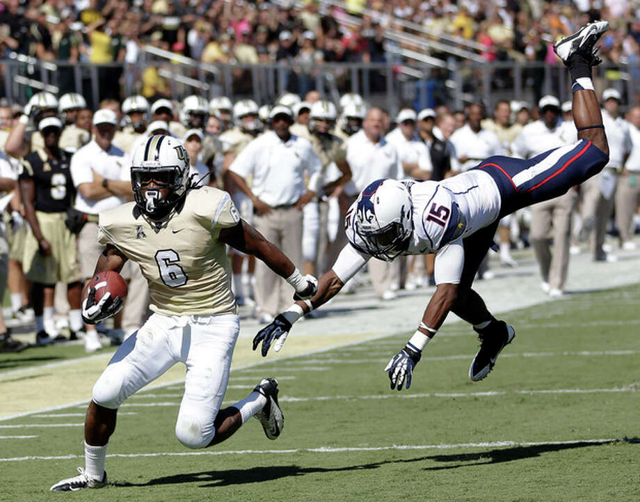Central Florida wide receiver Rannell Hall (6) runs for a 17-yard touchdown past Connecticut safety Ty-Meer Brown (15) during the first half of an NCAA college football game in Orlando, Fla., Saturday, Oct. 26, 2013.(AP Photo/John Raoux) / AP