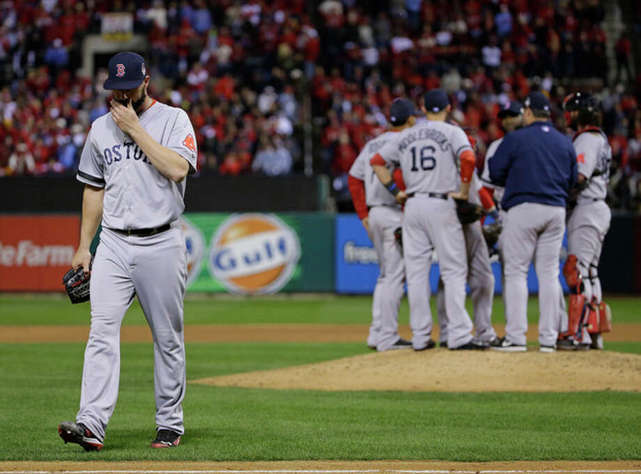 Boston Red Sox relief pitcher Brandon Workman walks off after being taken out of the game during the ninth inning of Game 3 of baseball's World Series against the St. Louis Cardinals Saturday, Oct. 26, 2013, in St. Louis. (AP Photo/Matt Slocum) / AP
