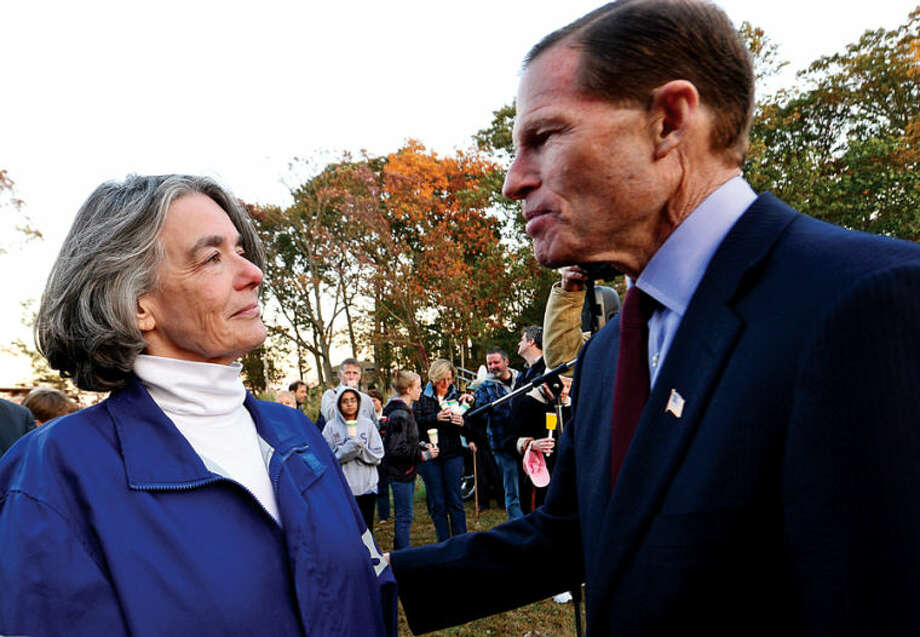 Hour photo / Erik Trautmann Senator Richard Blumenthal gives his support to Maggie Wilcox, wife of Capt. Peter Wilcox, during a candlelight vigil for him and the crew of Greenpeace's Arctic Sunrise Saturday at Village Creek. Wilcox and his crew are currently imprisoned in Russia on hooliganism charges after demonstrating in the arctic.