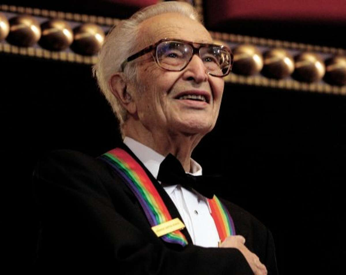 """In this Dec. 6, 2009 file photo, Kennedy Center honoree Dave Brubeck stands for the National Anthem at the Kennedy Center Honors gala in Washington. Brubeck, who turns 90 on Dec. 6, will celebrate the day by gathering in the family home in the Connecticut woods to watch Turner Classic Movies broadcast """"Dave Brubeck: In His Own Sweet Way."""" (AP Photo/Alex Brandon, File)"""