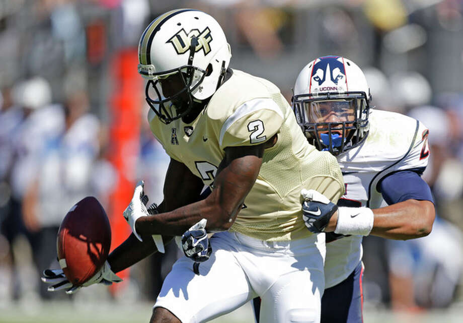 Connecticut safety Andrew Adams, right, breaks up a pass intended for Central Florida wide receiver Jeff Godfrey (2) during the first half of an NCAA college football game in Orlando, Fla., Saturday, Oct. 26, 2013.(AP Photo/John Raoux) / AP