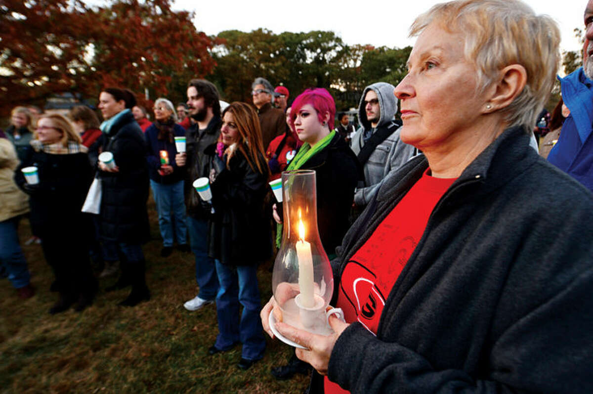 Hour photo / Erik Trautmann Marcia Powell attends a candlelight vigil for Capt. Peter Wilcox and the crew of Greenpeace's Arctic Sunrise saturday at Village Creek. Wilcox and his crew are currently imprisoned in Russia on hooliganism charges after demonstrating in the arctic.