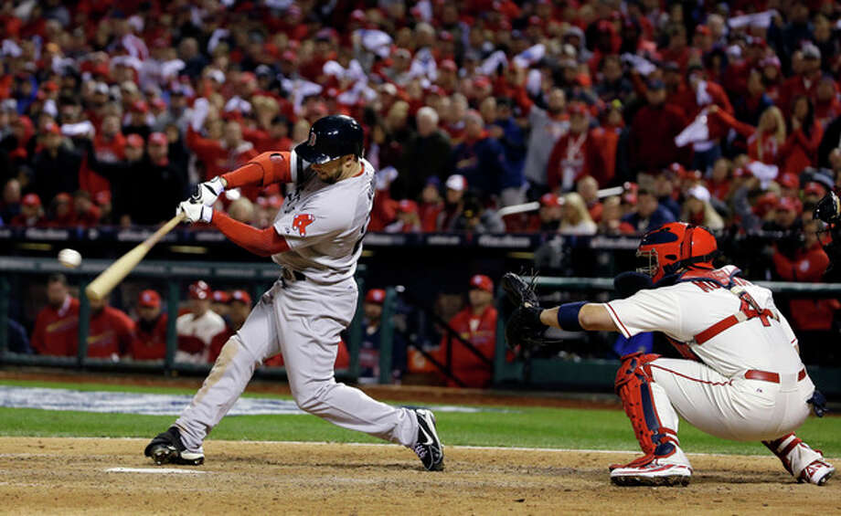 Boston Red Sox's Daniel Nava hits into a fielders choice during the eighth inning of Game 3 of baseball's World Series against the St. Louis Cardinals Saturday, Oct. 26, 2013, in St. Louis. Jacoby Ellsbury scored on the fields choice. (AP Photo/Matt Slocum) / AP