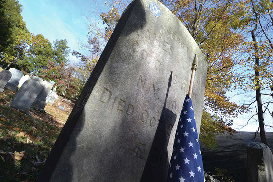 Hour photo / Alex von KleydorffThe headstone of James Jones stands in St. Matthew's cemetery in Wilton.