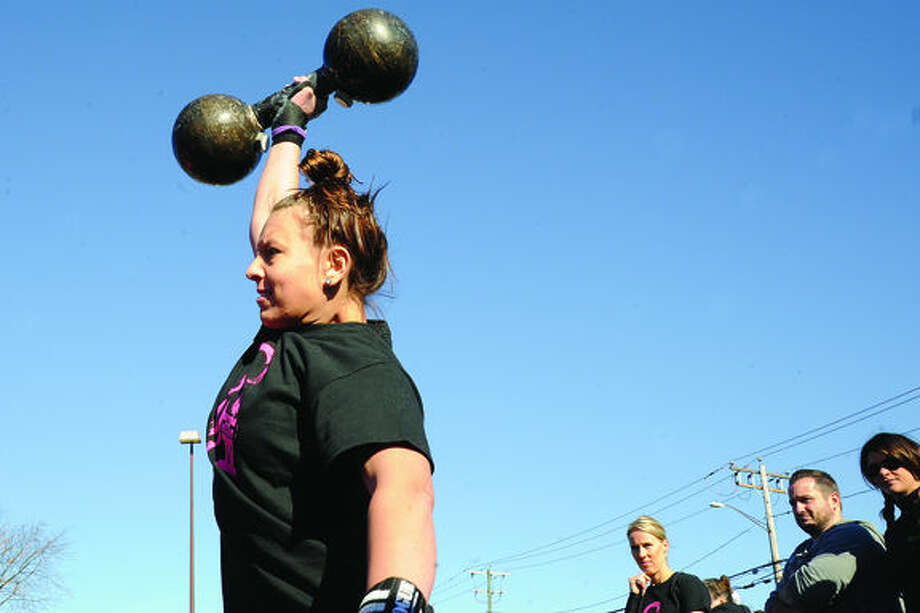 Kelsey Griffith competes in the press medley event Sunday at the Battle of the Belles strongwoman competition held at Punch Kettelbell Gym in Norwalk. Hour photo/Matthew Vinci