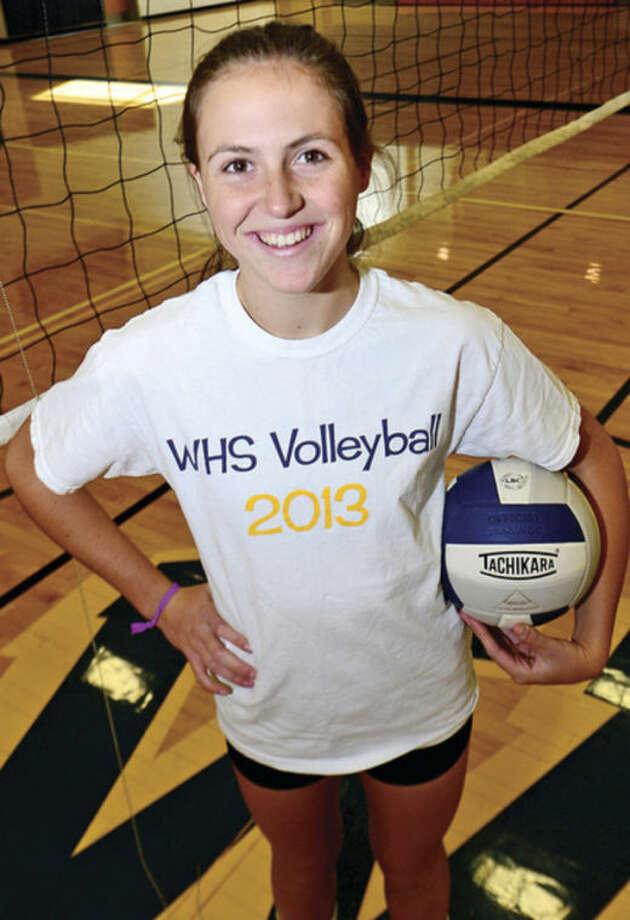Hour photo / Erik Trautmann Dana Mitchell, Weston High School volleyball player.