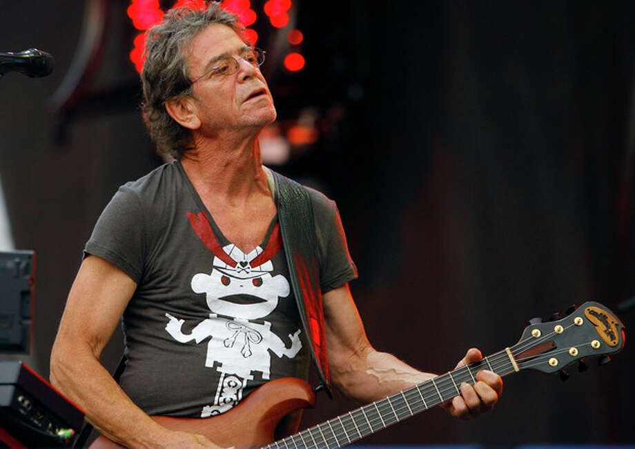 FILE - In this Sunday, Aug. 9, 2009 file photo, Lou Reed performs at the Lollapalooza music festival, in Chicago. Punk-poet, rock legend Lou Reed is dead of a liver-related ailment, his literary agen said Sunday, Oct. 27, 2013. He was 71. (AP Photo/John Smierciak, File) / FR170074 AP