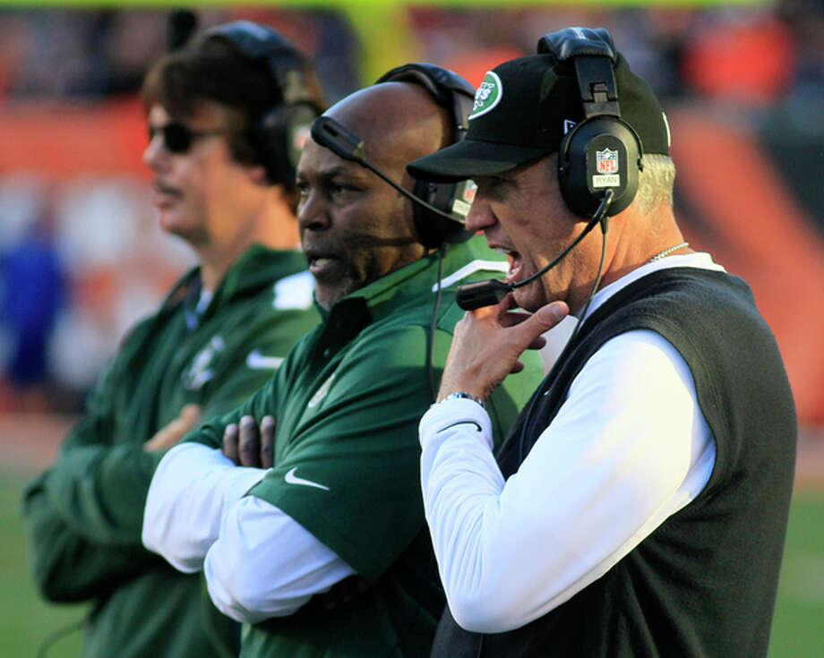 New York Jets head coach Rex Ryan, right, watches on the sidelines during the first half of an NFL football game against the Cincinnati Bengals, Sunday, Oct. 27, 2013, in Cincinnati. (AP Photo/Tom Uhlman) / FR31154 AP