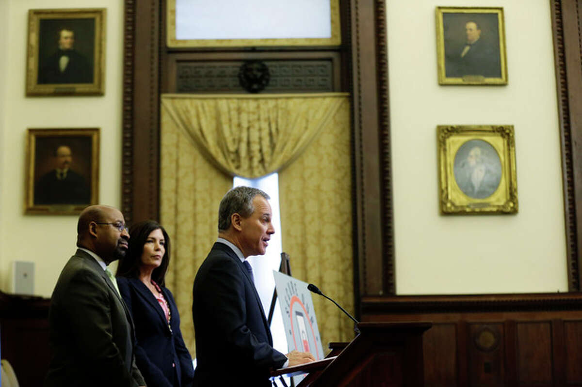 New York Attorney General Eric Schneiderman, center, speaks as Pennsylvania Attorney General Kathleen Kane, second left, and Philadelphia Mayor Michael Nutter look on during a news conference Monday, Oct. 28, 2013, at City Hall in Philadelphia. Schneiderman, Nutter, Kane are joining top prosecutors in San Francisco and New York in a nationwide initiative to thwart smartphone thefts. (AP Photo/Matt Rourke)