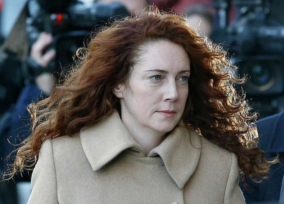 Rebekah Brooks arrives at The Old Bailey law court in London, Monday, Oct. 28, 2013. Former News of the World national newspaper editors Rebekah Brooks and Andy Coulson are due to go on trial Monday, along with several others, on charges of hacking phones and bribing officials while at the now closed tabloid paper.(AP Photo/Kirsty Wigglesworth) / AP