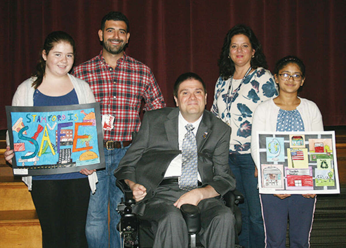 In the picture above from left to right Victoria Wood, Matt DiGiovanna (art teacher), state Rep. Michael Molgano, Jennifer Marchetti (art teacher), and Ayusha Gautam.