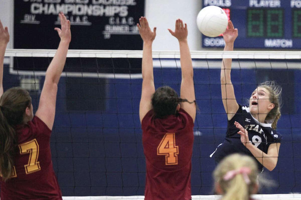 Hour Photo/Chris Palermo Staples' Lauren Mushro kills the ball during the FCIAC quarterfilnals against St. Joseph Monday night at Staples High School in Westport.