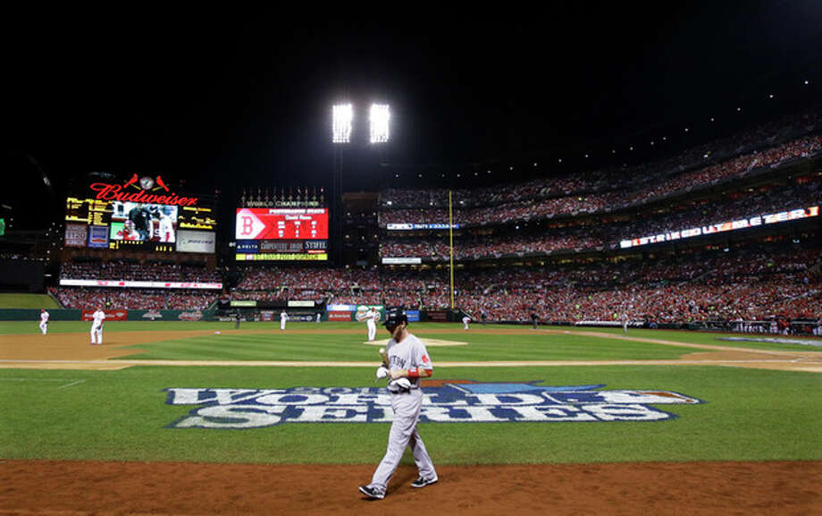 Boston Red Sox shortstop Stephen Drew walks back to the dugout after striking out to St. Louis Cardinals starting pitcher Adam Wainwright in the second inning of Game 5 of baseball's World Series Monday, Oct. 28, 2013, in St. Louis. (AP Photo/Matt Slocum) / AP
