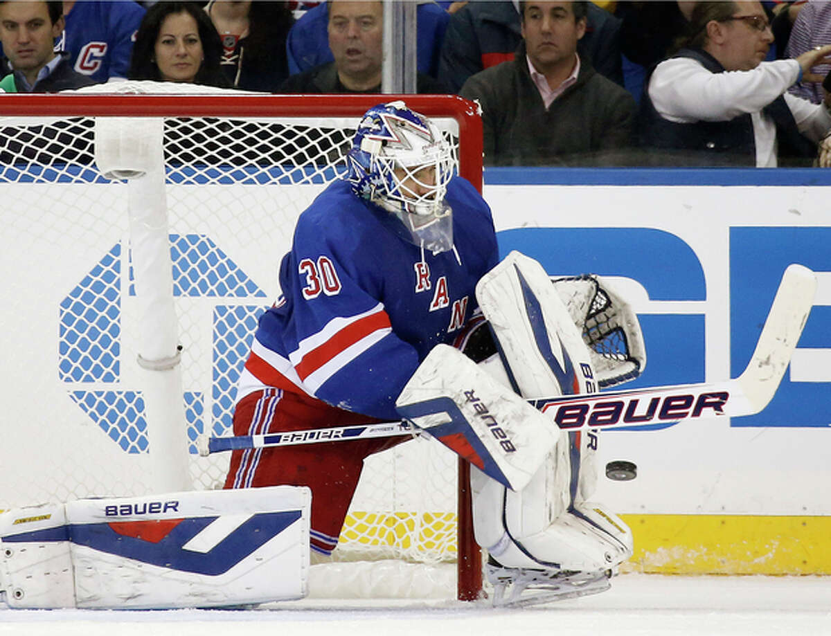 New York Rangers goalie Henrik Lundqvist of Sweden makes a save in the second period of their NHL hockey game against the Montreal Canadiens at Madison Square Garden in New York, Monday, Oct. 28, 2013. (AP Photo/Kathy Willens)