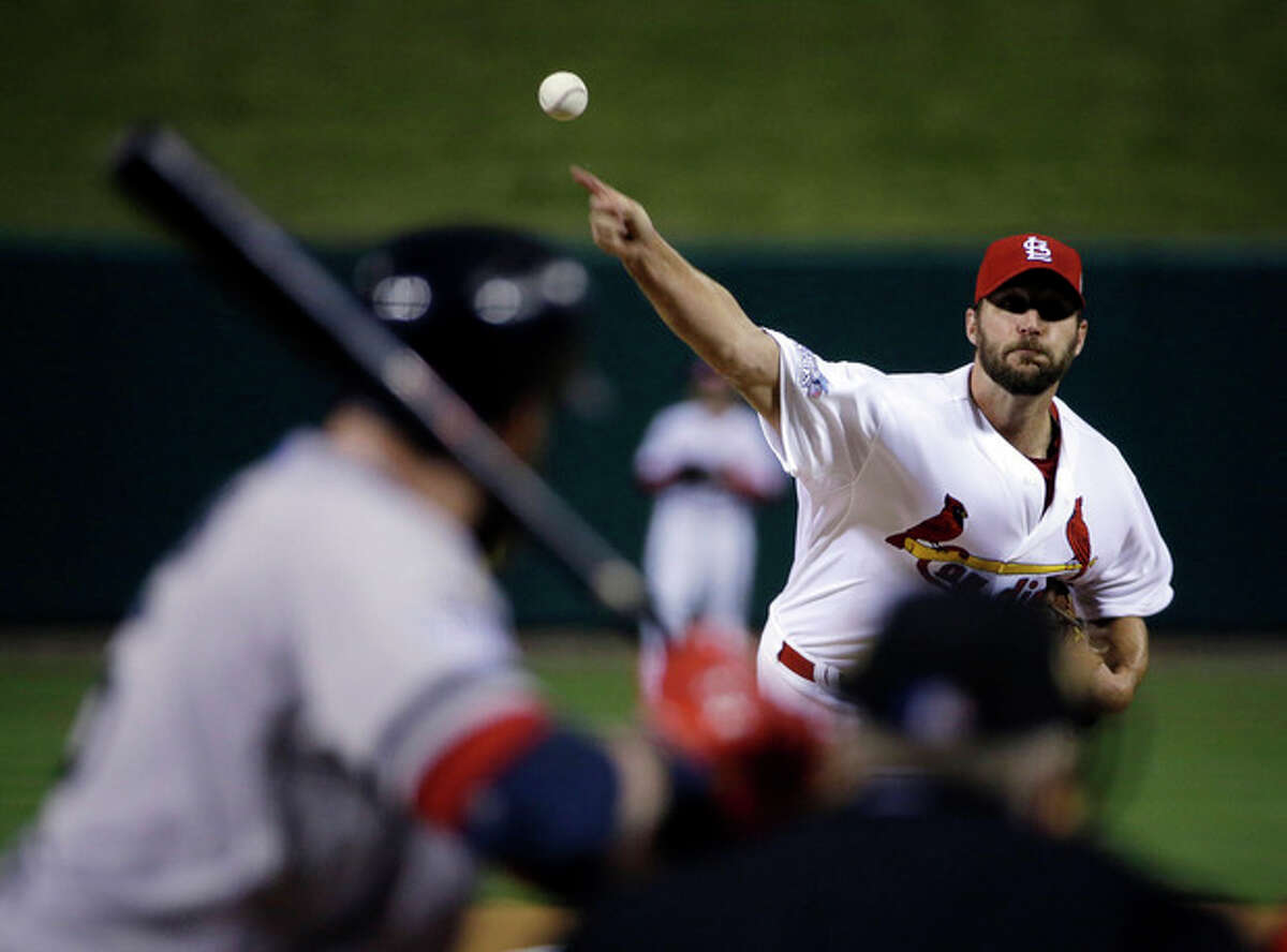 St. Louis Cardinals starting pitcher Adam Wainwright throws during the first inning of Game 5 of baseball's World Series against the Boston Red Sox Monday, Oct. 28, 2013, in St. Louis. (AP Photo/David J. Phillip)
