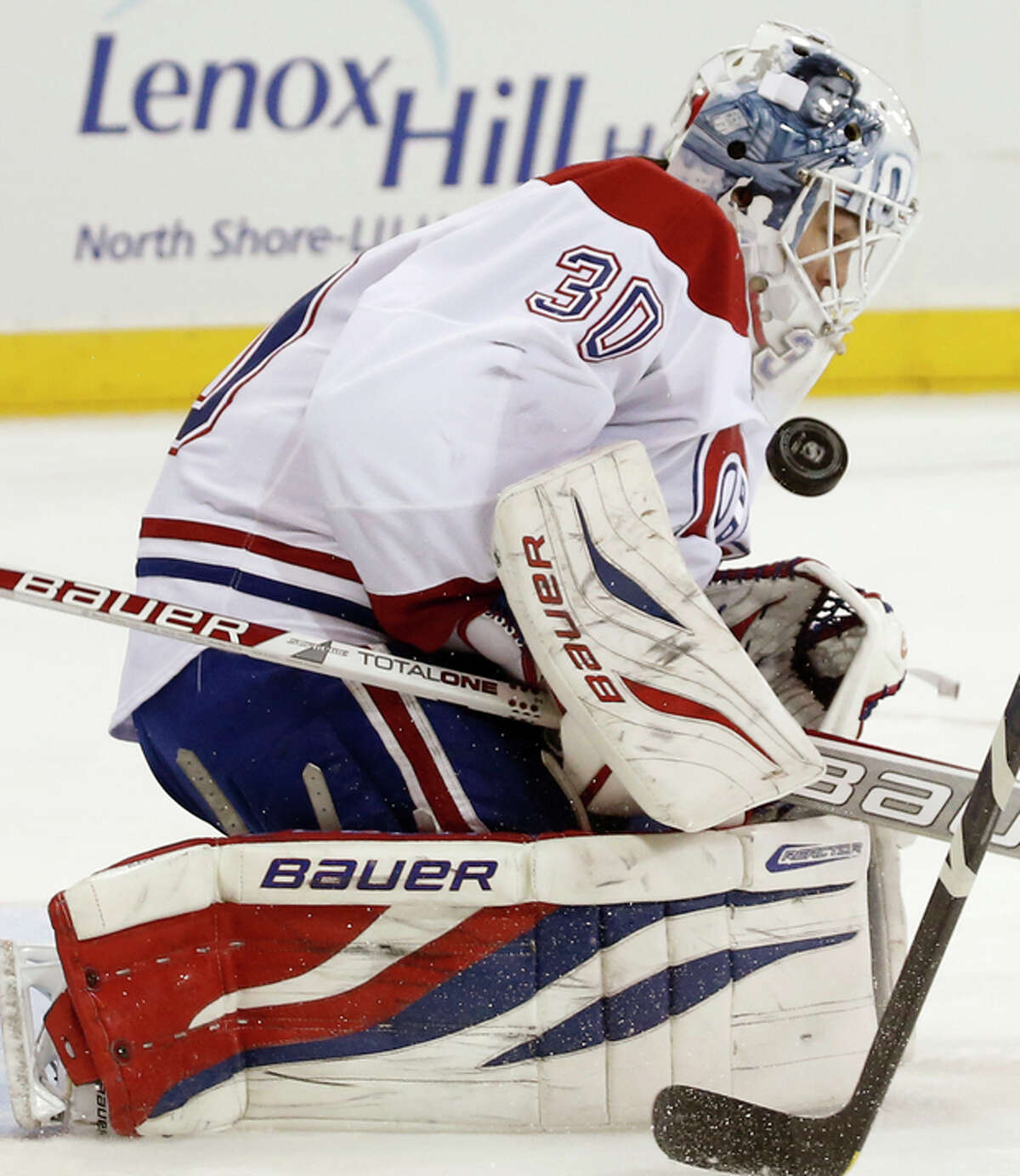 Montreal Canadiens goalie Peter Budaj of the Czech Republic makes a save in the second period of their NHL hockey game at Madison Square Garden in New York, Monday, Oct. 28, 2013. (AP Photo/Kathy Willens)