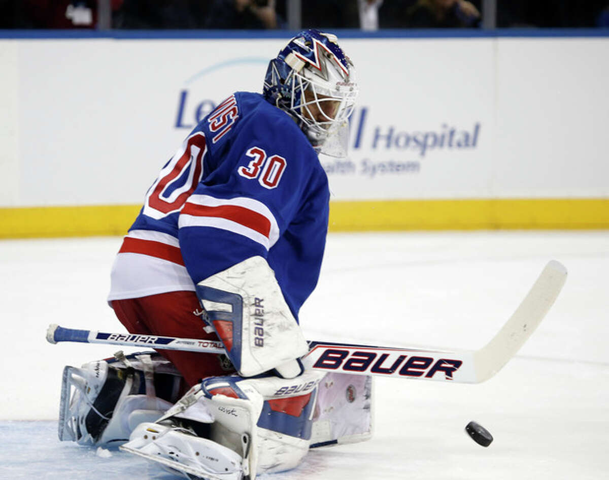 New York Rangers goalie Henrik Lundqvist of Sweden makes a save in the first period of the Rangers NHL hockey game against the Montreal Canadiens at Madison Square Garden in New York, Monday, Oct. 28, 2013. (AP Photo/Kathy Willens)