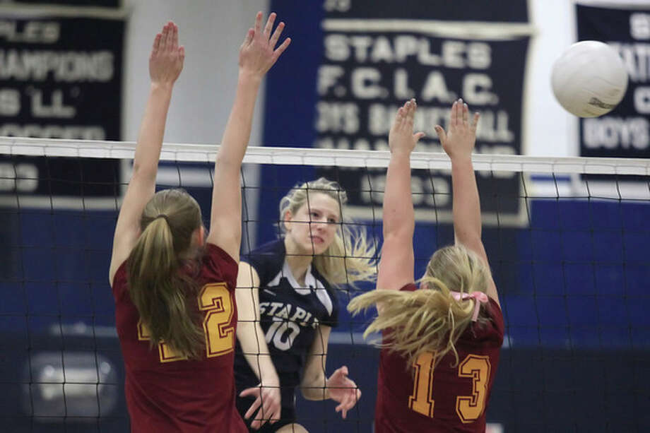 Hour Photo / Chris Palermo. Staples' Amelia Brackett digs the ball during the FCIAC quarterfilnals against St. Joseph Monday night at Staples High School. / © 2013 Hour Newspapers All Rights Reserved