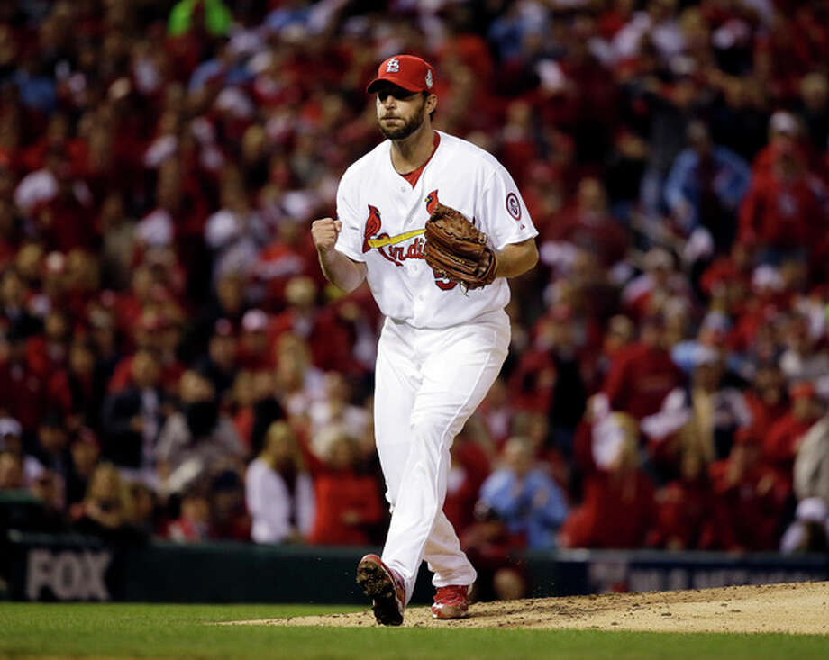 St. Louis Cardinals starting pitcher Adam Wainwright reacts after striking out Boston Red Sox's Jacoby Ellsbury to end the top of the fifth inning of Game 5 of baseball's World Series Monday, Oct. 28, 2013, in St. Louis. (AP Photo/Jeff Roberson) / AP
