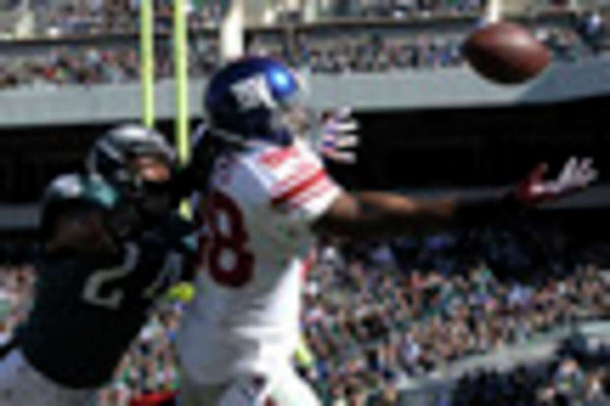 Philadelphia Eagles cornerback Bradley Fletcher (24) defends New York Giants wide receiver Hakeem Nicks (88) during the first half of an NFL football game Sunday, Oct. 27, 2013 in Philadelphia. The pass was incomplete on the play. (AP Photo/Michael Perez)