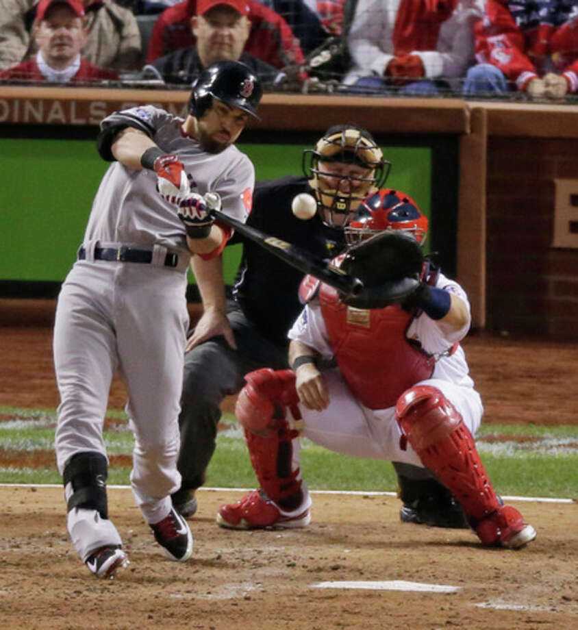 Boston Red Sox's Jacoby Ellsbury hits an RBI single during the seventh inning of Game 5 of baseball's World Series against the St. Louis Cardinals Monday, Oct. 28, 2013, in St. Louis. (AP Photo/Charlie Riedel) / AP