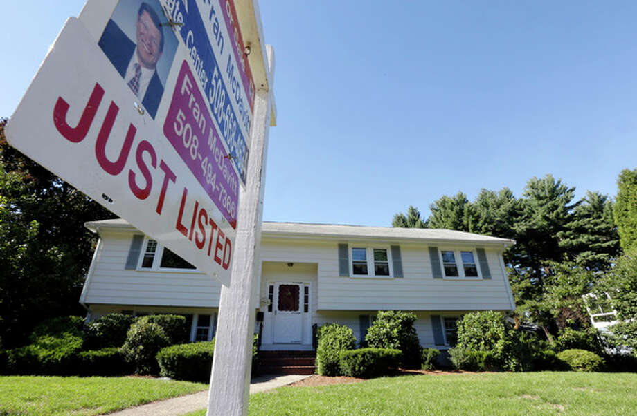"FILE - In this Wednesday, Sept. 18, 2013, file photo, a ""For Sale"" sign hangs in front of a house in Walpole, Mass. Standard & Poor's releases the S&P Case-Shiller index of home prices for August, on Tuesday, Oct. 29, 2013. (AP Photo/Steven Senne, File) / AP"