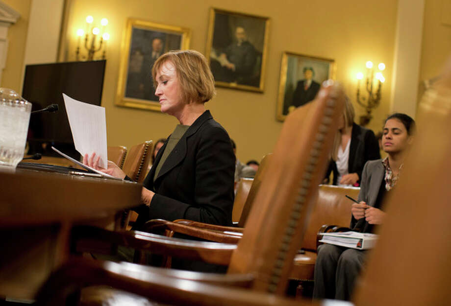 Marilyn Tavenner, the administrator of the Centers for Medicare and Medicaid Services, goes over her notes on Capitol Hill in Washington, Tuesday, Oct. 29, 2013, prior to testifying before the House Ways and Means Committee hearing on the implementation of the Affordable Care Act. Stressing that improvements are happening daily, the senior Obama official closest to the administration's malfunctioning health care website apologized Tuesday for problems that have kept Americans from successfully signing up for coverage. (AP Photo/ Evan Vucci) / AP