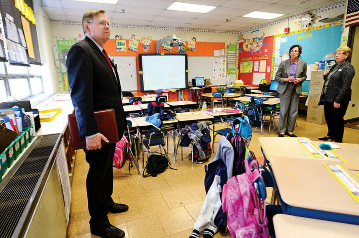 Hour photo / Erik Trautmann David Martin, Democratic candidate for Mayor, tours Springdale Elementary School with principal Anne Downey and Board of Ed member Jackie Heftman Tuesday, where he learns about the overcrowding issue facing the school.