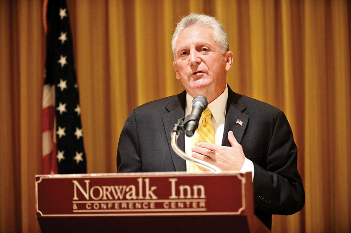Hour photo / Erik Trautmann Democratic candidate for mayor Harry Rilling and incumbent mayor Richard Moccia debate at the Norwalk Inn and Conference Center Tuesday morning.