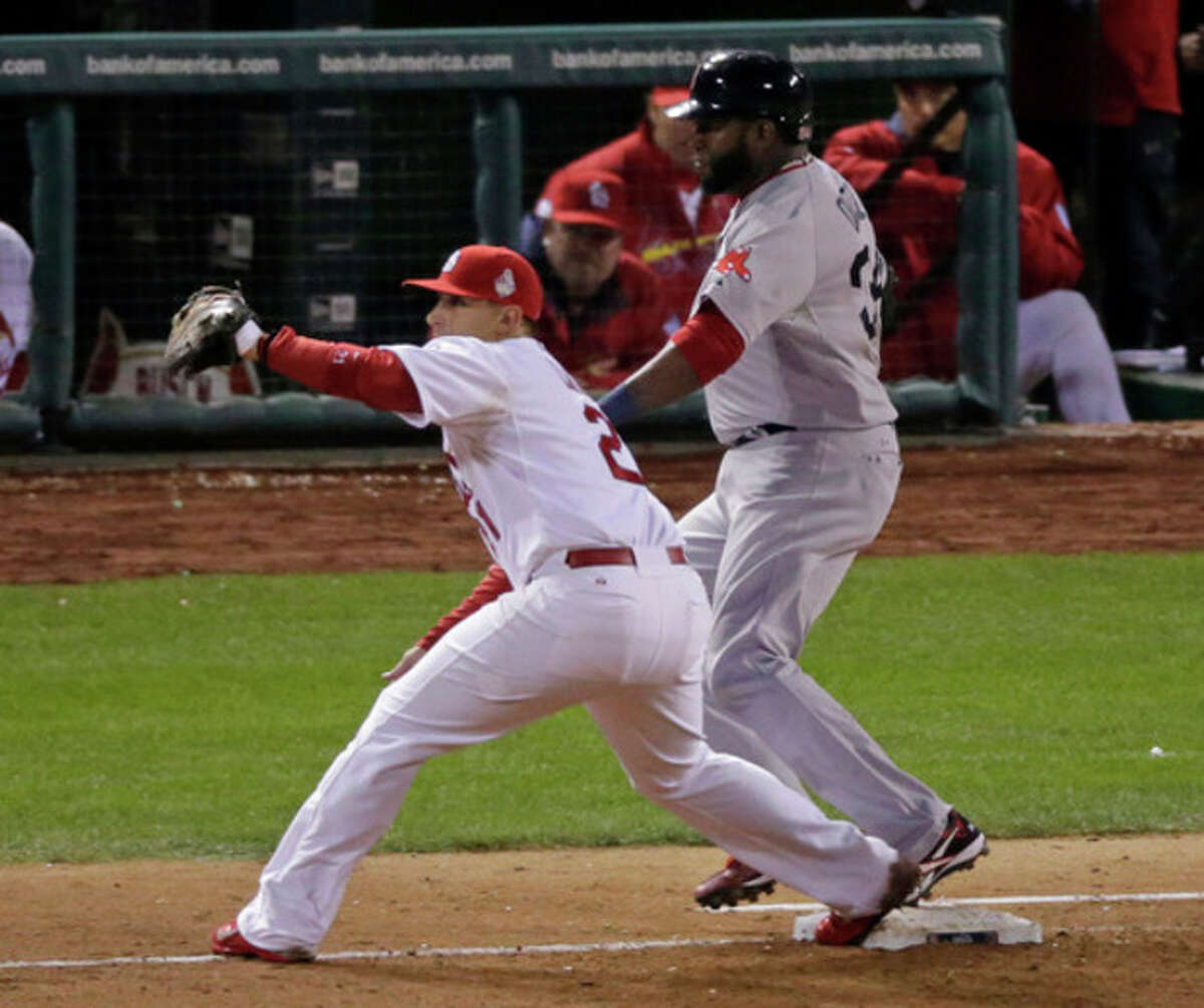 Boston Red Sox's David Ortiz is safe at first following a single to right field during the eighth inning of Game 5 of baseball's World Series Monday, Oct. 28, 2013, in St. Louis. St. Louis Cardinals first baseman Allen Craig takes the throw. (AP Photo/Charlie Riedel)
