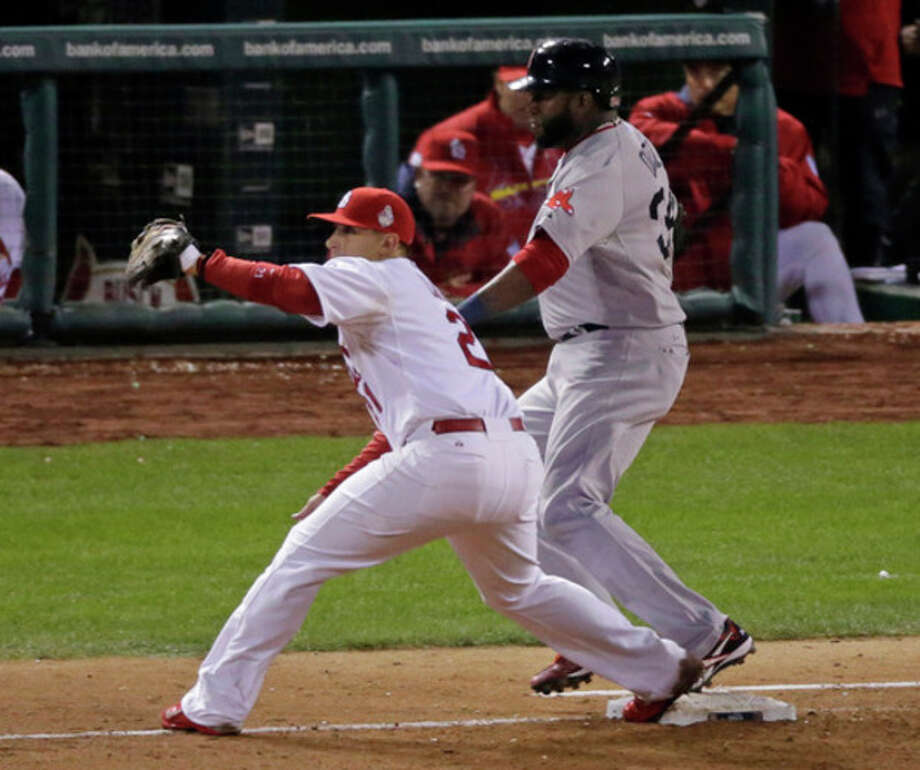 Boston Red Sox's David Ortiz is safe at first following a single to right field during the eighth inning of Game 5 of baseball's World Series Monday, Oct. 28, 2013, in St. Louis. St. Louis Cardinals first baseman Allen Craig takes the throw. (AP Photo/Charlie Riedel) / AP