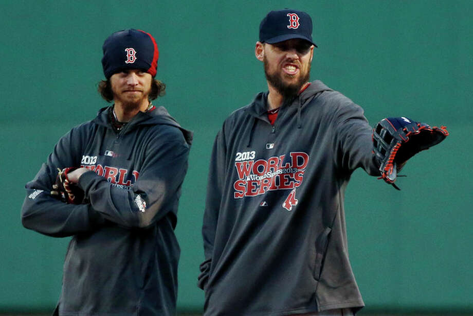 Boston Red Sox pitchers Clay Buchholz, left, and John Lackey stand together during a workout at Fenway Park in Boston, Tuesday, Oct. 29, 2013. Lackey is scheduled to start Game 6 of baseball's World Series against the St. Louis Cardinals on Wednesday in Boston. (AP Photo/Elise Amendola) / AP