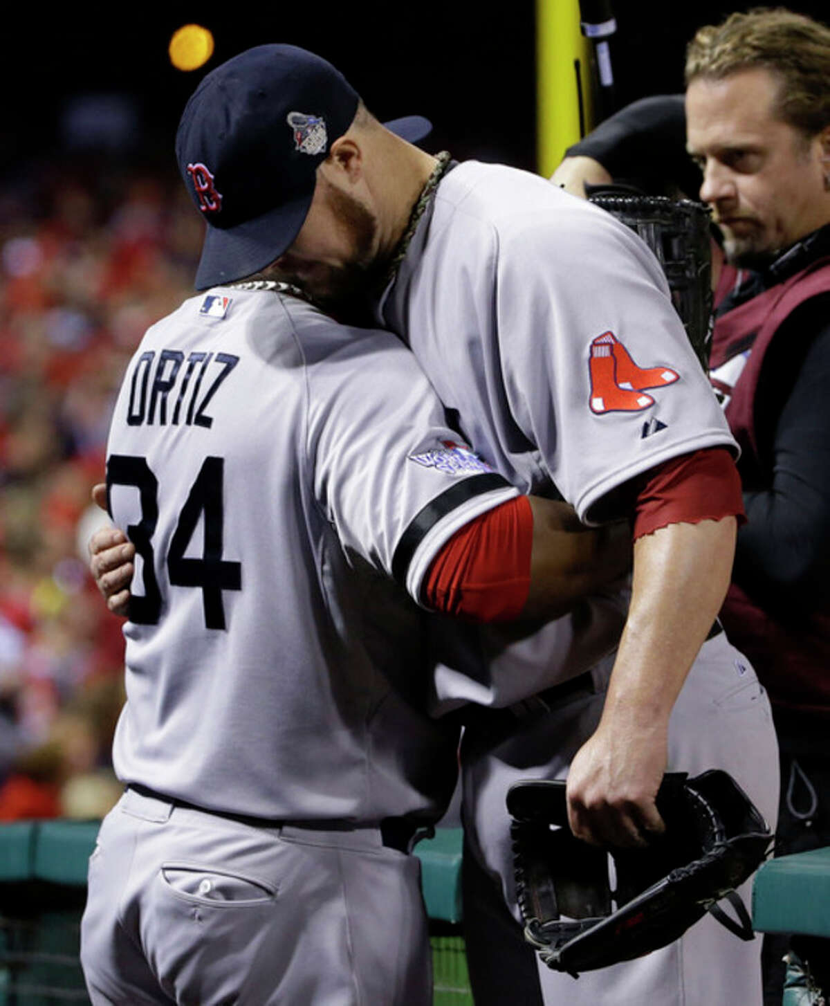 Boston Red Sox David Ortiz, left, hugs Jon Lester after they were pulled from the game during the eighth inning of Game 5 of baseball's World Series against the St. Louis Cardinals Monday, Oct. 28, 2013, in St. Louis. (AP Photo/Matt Slocum)
