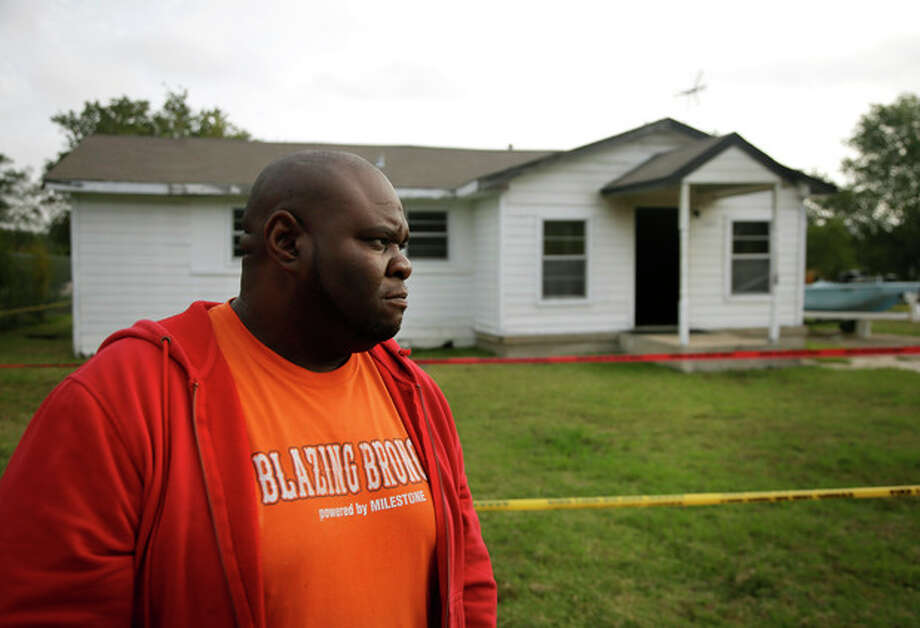 Terrence Walker of Forney, Texas, the brother of 36-year-old Charles Everett Brownlow Jr., stands in front of their mother, Mary Brownlow's house as he answers a reporters question, Tuesday, Oct. 29, 2013, in Terrell, Texas. Police arrested Charles Everett Brownlow Jr. early Tuesday who is suspected of killing five people, including his mother, during a series of attacks hours earlier in his rural North Texas community. Mary Brownlow,was found dead Monday evening in the house where a fire was set and very clearly an arson, according to authorities. (AP Photo/Tony Gutierrez) / AP