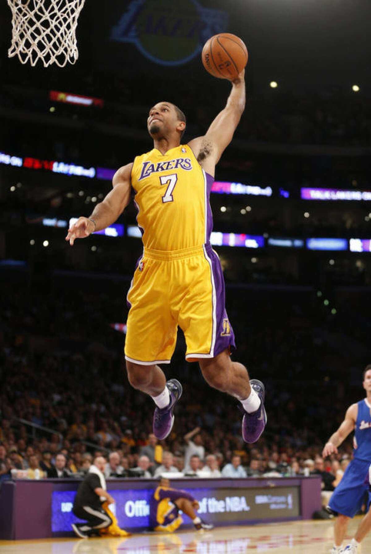 Los Angeles Lakers' Xavier Henry dunks the ball against the Los Angeles Clippers during the first half of an NBA basketball game in Los Angeles, Tuesday, Oct. 29, 2013. (AP Photo/Danny Moloshok)