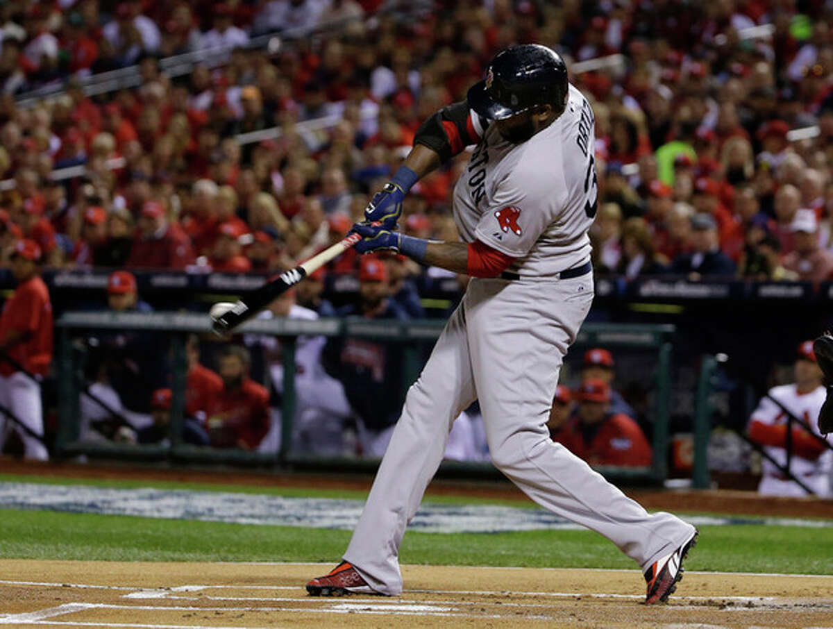 Boston Red Sox designated hitter David Ortiz hits an RBI double during the first inning of Game 5 of baseball's World Series against the St. Louis Cardinals Monday, Oct. 28, 2013, in St. Louis. (AP Photo/Matt Slocum)