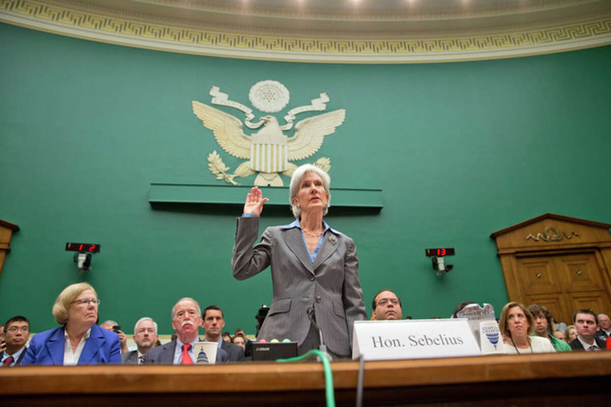 Health and Human Services Secretary Kathleen Sebelius is sworn in on Capitol Hill in Washington, Wednesday, Oct. 30, 2013, prior to testifying before the House Energy and Commerce Committee hearing on the difficulties plaguing the implementation of the Affordable Care Act. President Barack Obama's top health official faced tough questioning by a congressional committee Wednesday that will demand she explain how the administration stumbled so badly in its crippled online launch of the president's health care overhaul. (AP Photo/ J. Scott Applewhite)