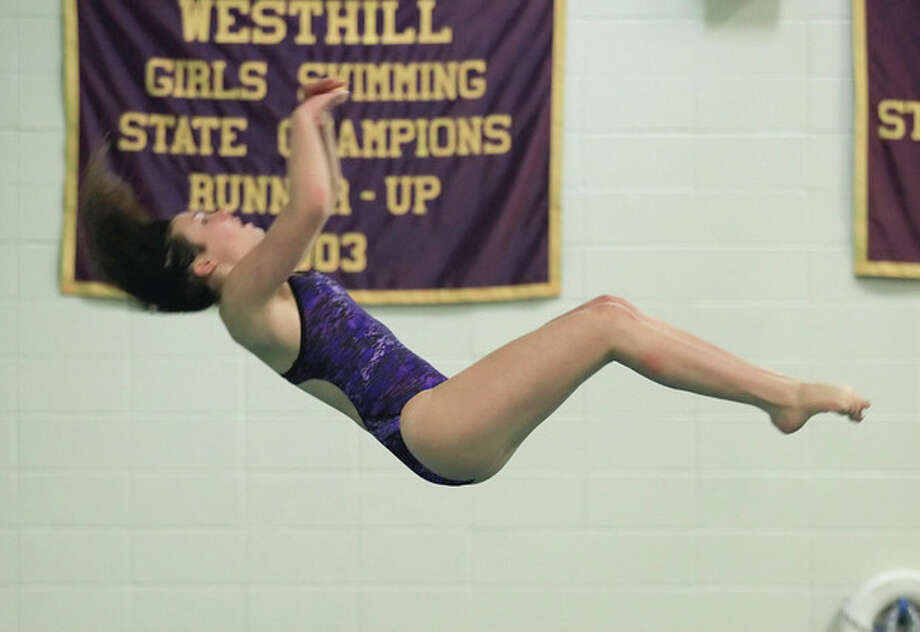 Hour Photo / Chris Palermo. Rachael Burston of Westhill High School perfoms a dive at the FCIACDiving Championships at Westhill High School Tuesday evening. / © 2013 Hour Newspapers All Rights Reserved